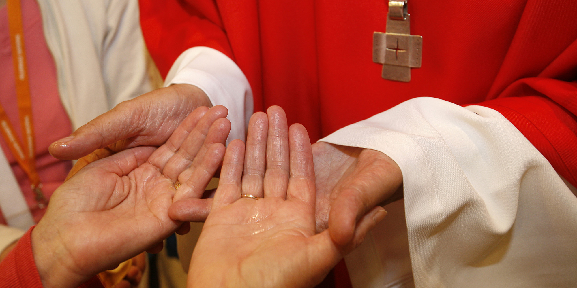 Bishop anointing a sick person (Photo by: Godong/Universal Images Group via Getty Images)